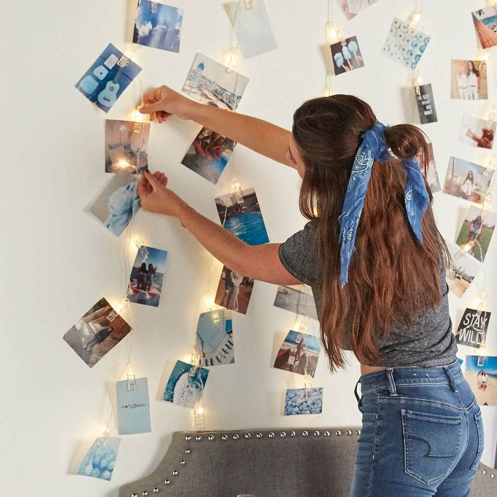 Photo wall ideas for college - string clip lights with photos