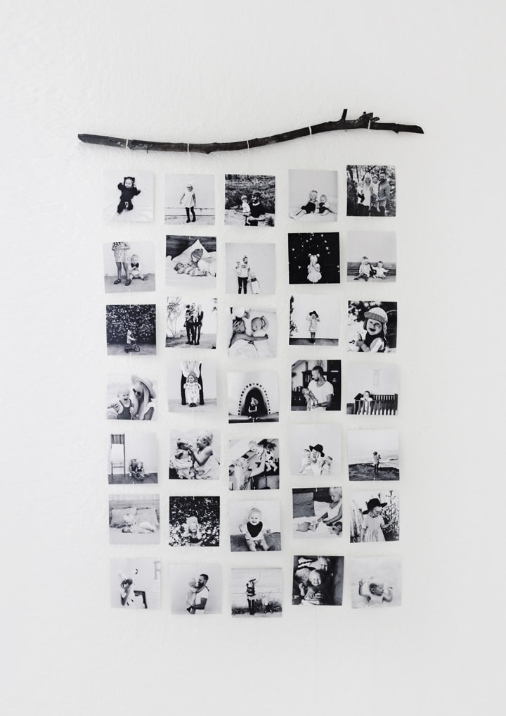 black and white photos hanging from a stick