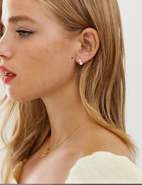 Double pearl studs from ASOS inspired by Carla Elite style