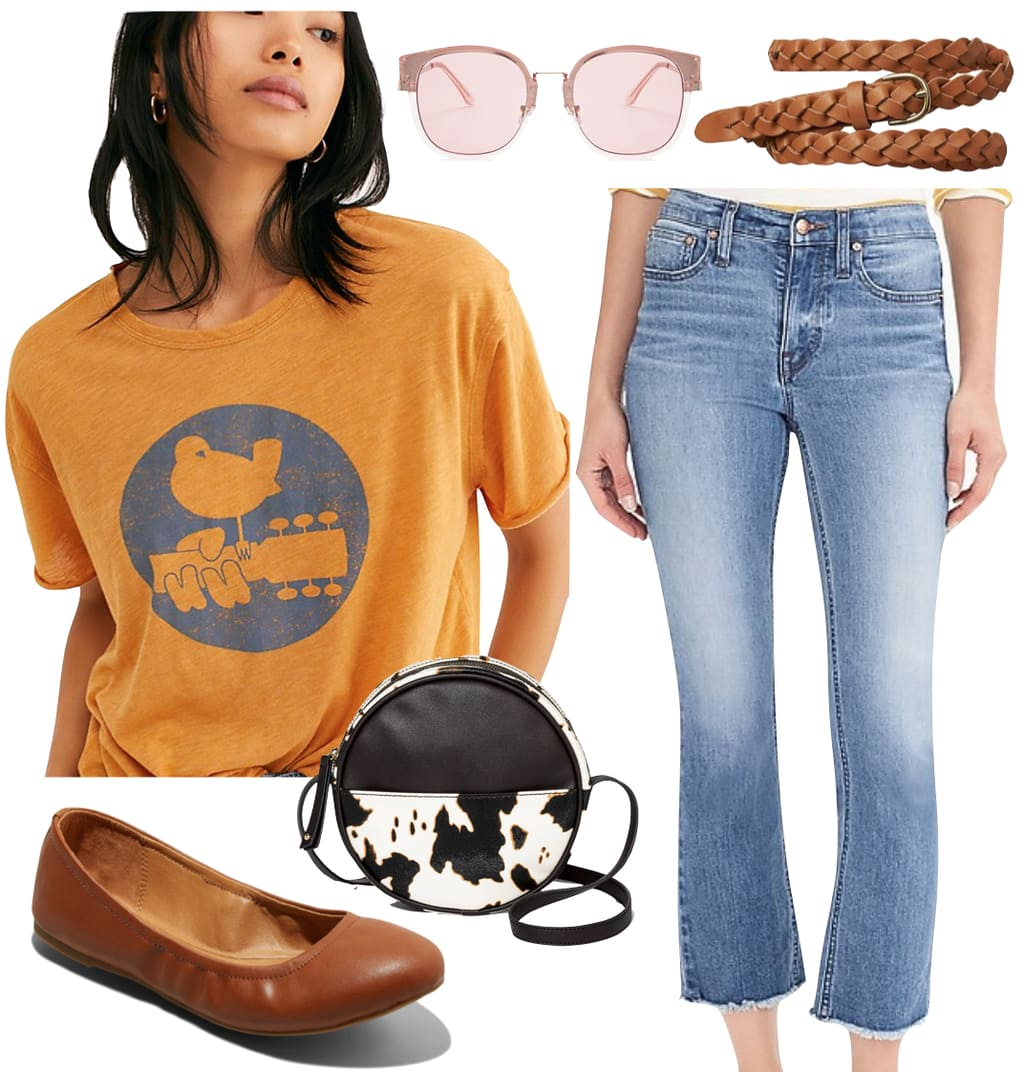 Emma Roberts Outfit: orange graphic print t-shirt, cropped ankle flare jeans, brown braided belt, sunglasses, cow print bag, and brown faux leather flats
