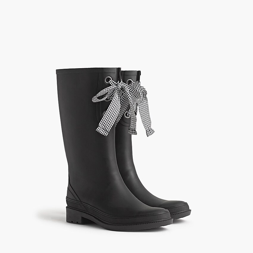 Seven Cute Pairs of Rain Boots to Jazz Up Your Rainy Day Look: J.Crew Tall Lace-Up Rain Boots in black with black-and-white gingham ribbon lace-up detail