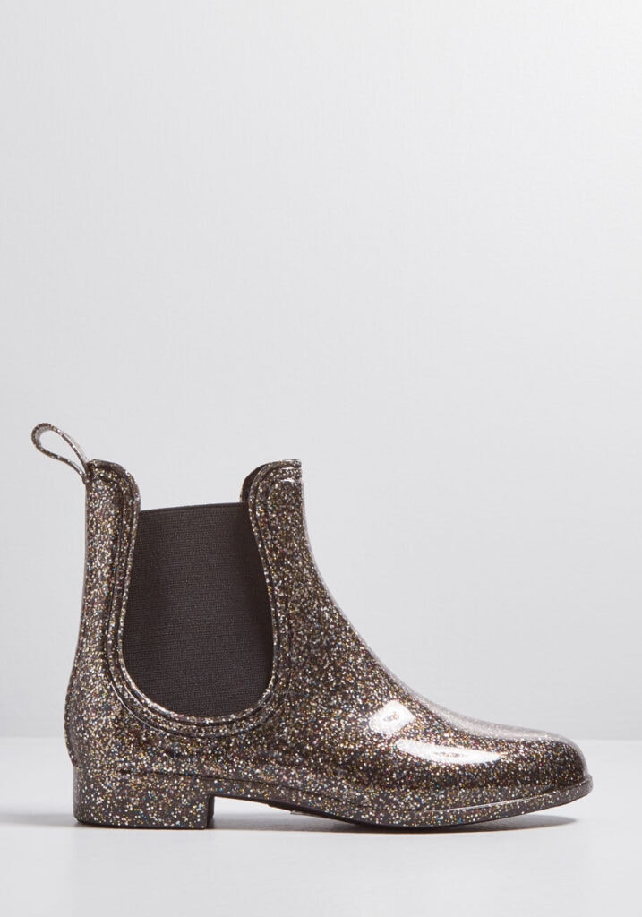 Seven Cute Pairs of Rain Boots to Jazz Up Your Rainy Day Look: Report Footwear Slicker Rain Boot in pewter glitter