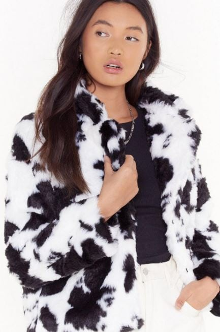 Cow print faux fur coat from Nasty Gal