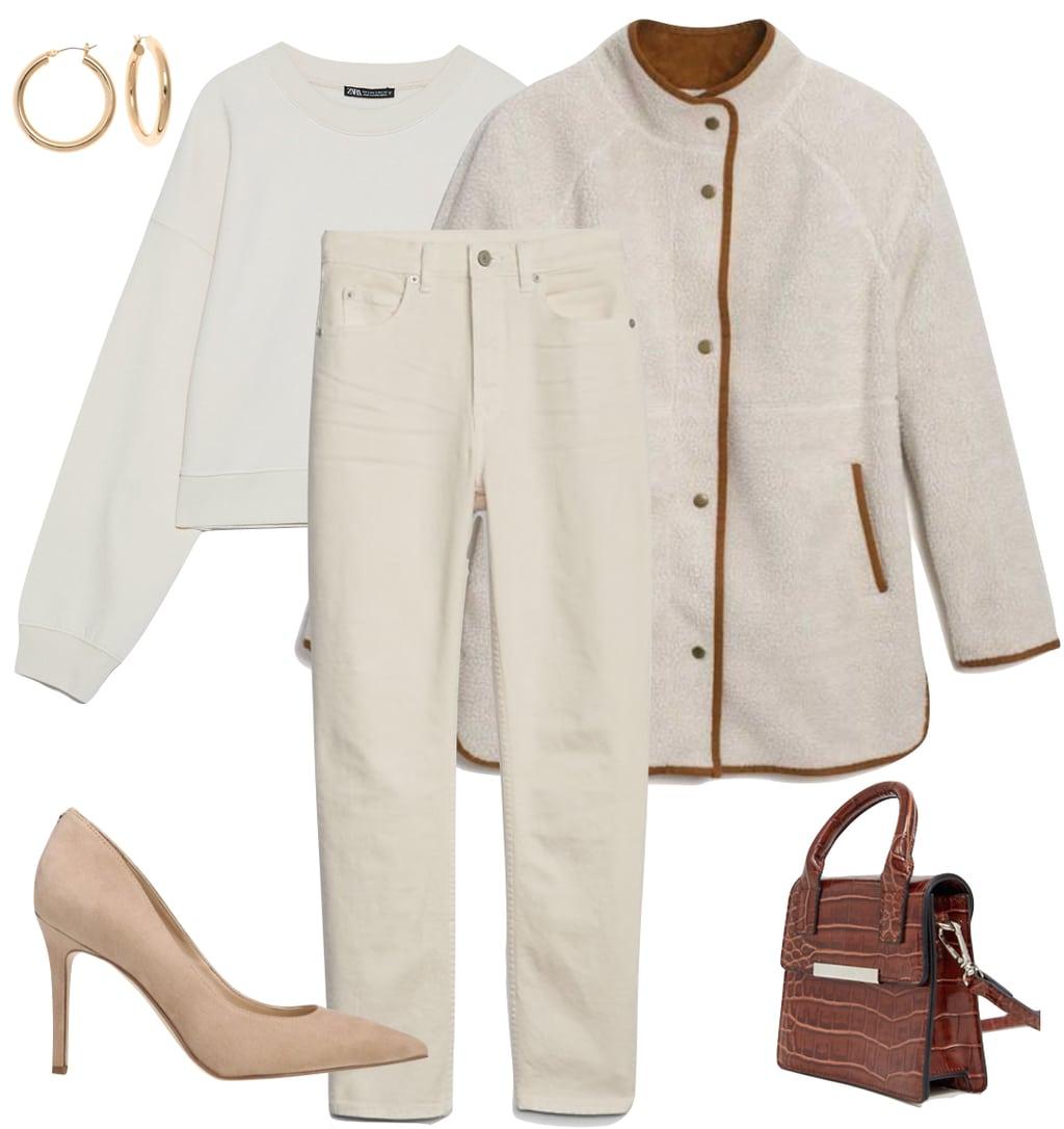 Hailey Bieber Outfit: ecru jeans, ecru sweatshirt, cream sherpa jacket, chunky gold hoop earrings, beige pumps, brown croc mini bag