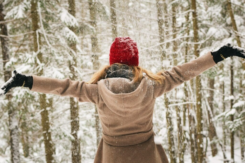 Girl with arms outstretched in snow.