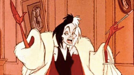 Cruella de Vil in her white and red coat with black dress