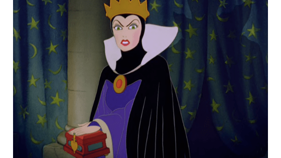 Evil queen fashion - the evil queen in snow white wearing a purple cape and gold crown