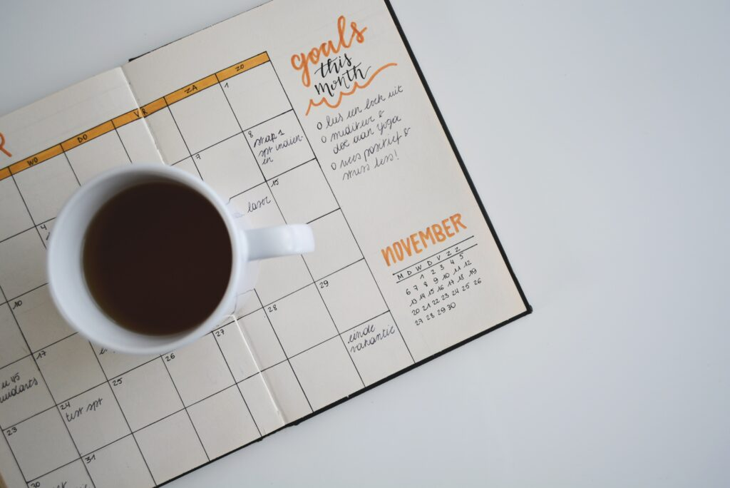 coffee cup on open planner
