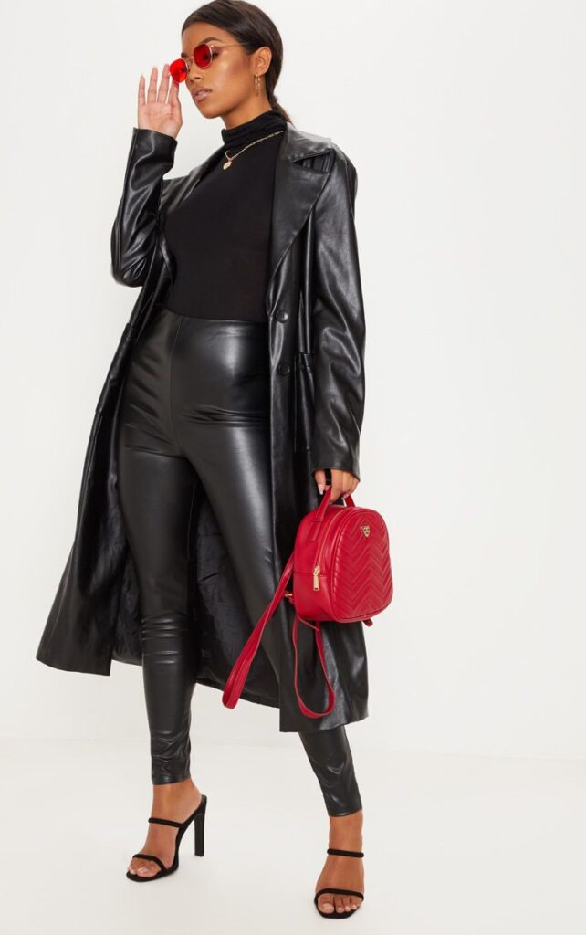 Faux leather leggings paired with a leather trench coat