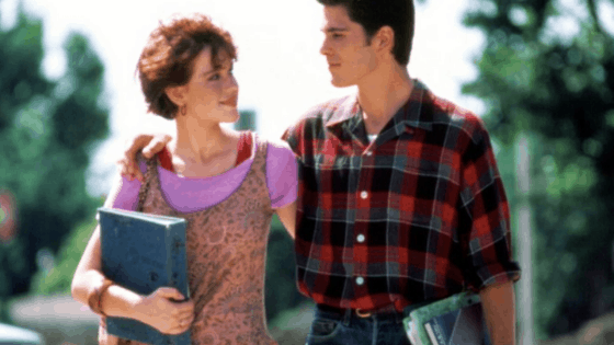 Sixteen Candles fashion - Samantha wearing a leopard dress, purple t-shirt, and red tank top while walking with Jake Ryan