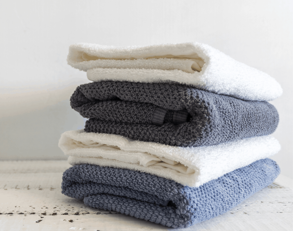 How to keep clothes looking new - pile of sweaters