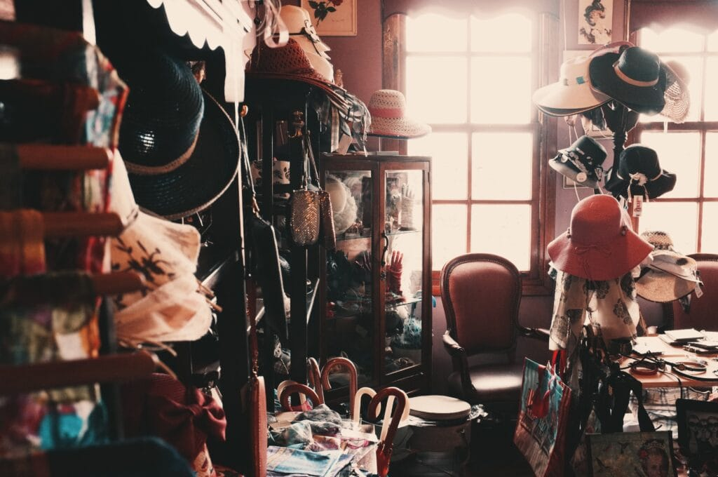 cluttered room with hats