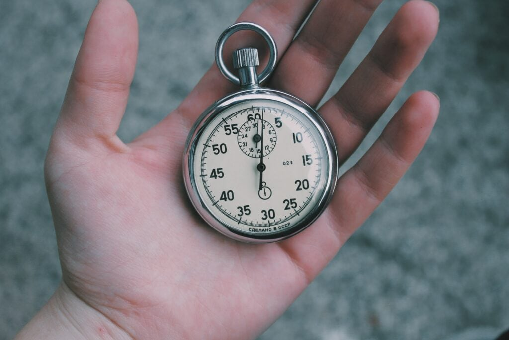 person holding stopwatch