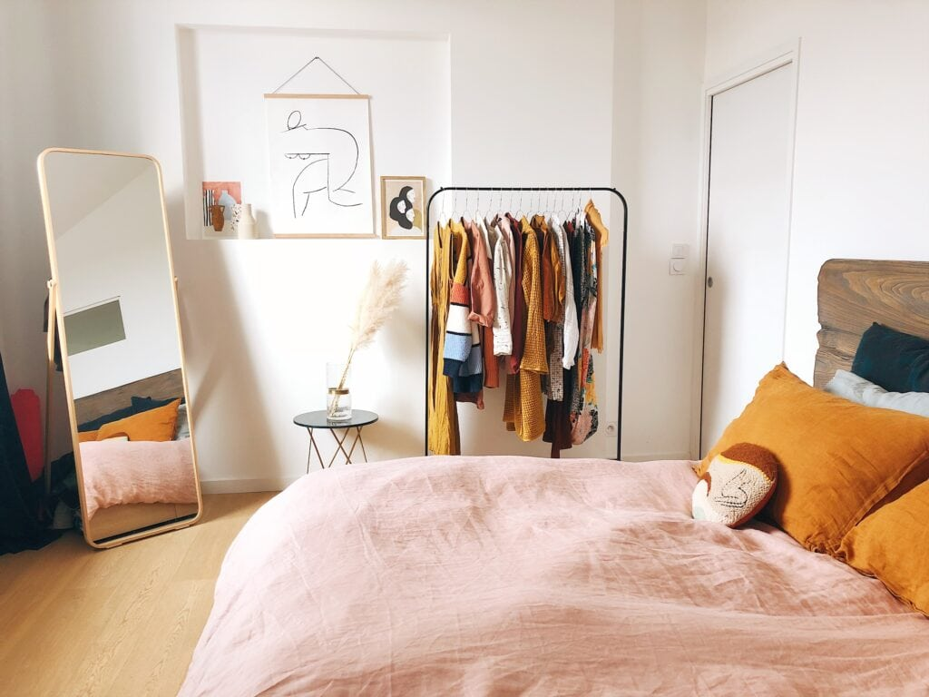 Decluttering tips - bedroom with pink bed