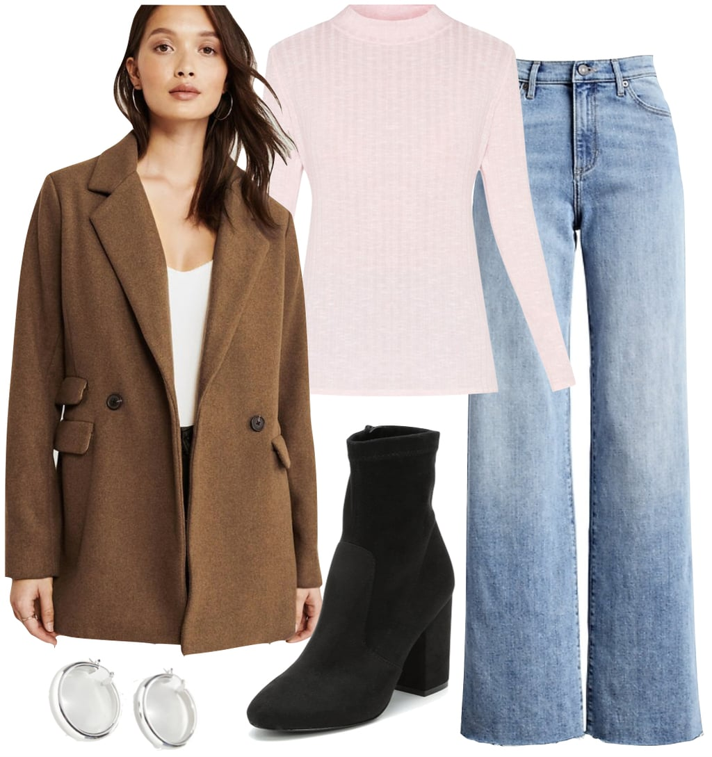 Selena Gomez Outfit #2: brown wool blazer coat, light pink mock neck top, high-rise wide leg jeans, black sock boots, and chunky silver hoop earrings