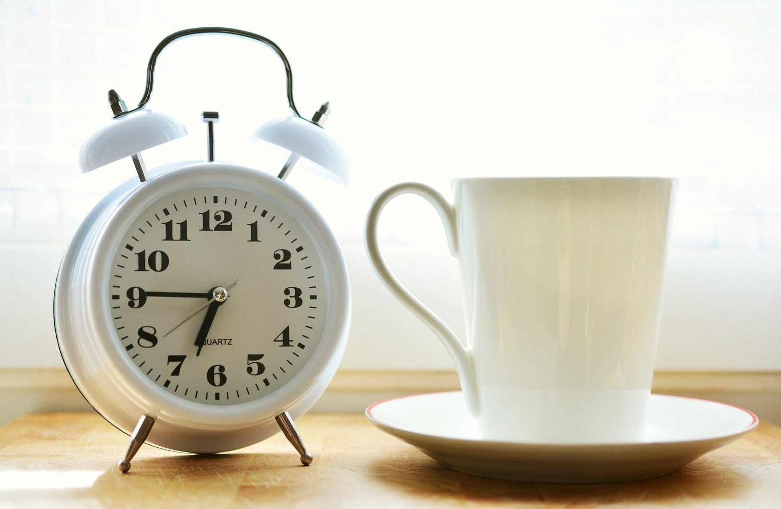 Alarm clock and coffee cup