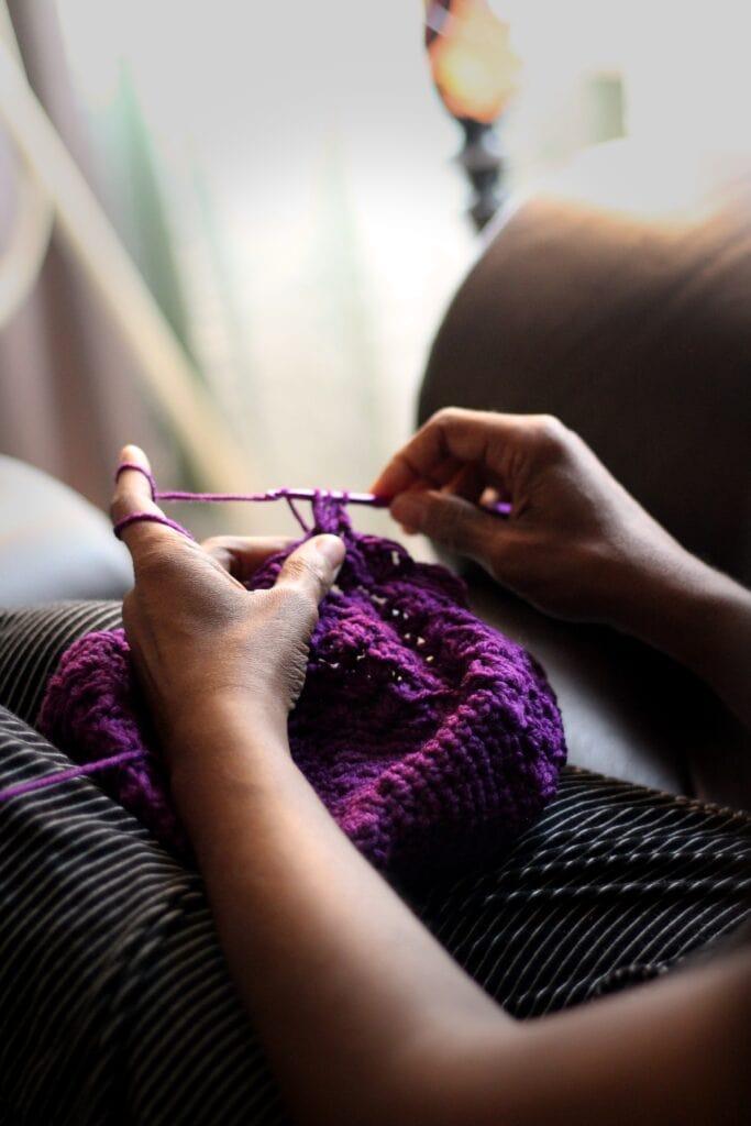 crocheting with purple yarn