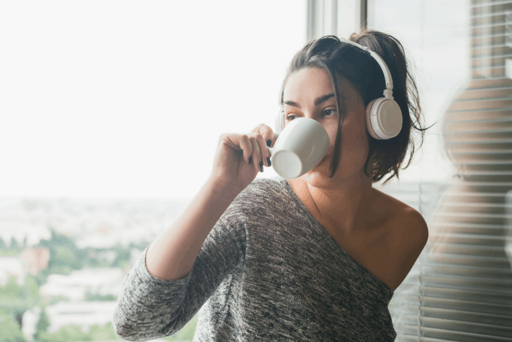 New Years resolutions for students: Photo of a student with a cup of coffee and headphones