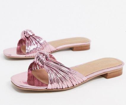 Metallic pink slides.