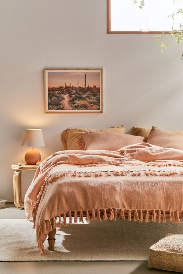 Urban Outfitters salmon comforter with fringe.