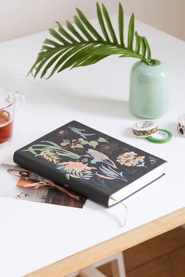 Image of journal on desk for sleeping tips