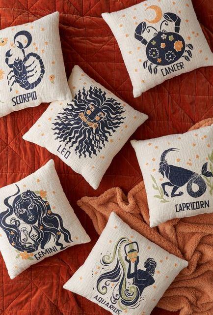 Blue and gold zodiac pillows.