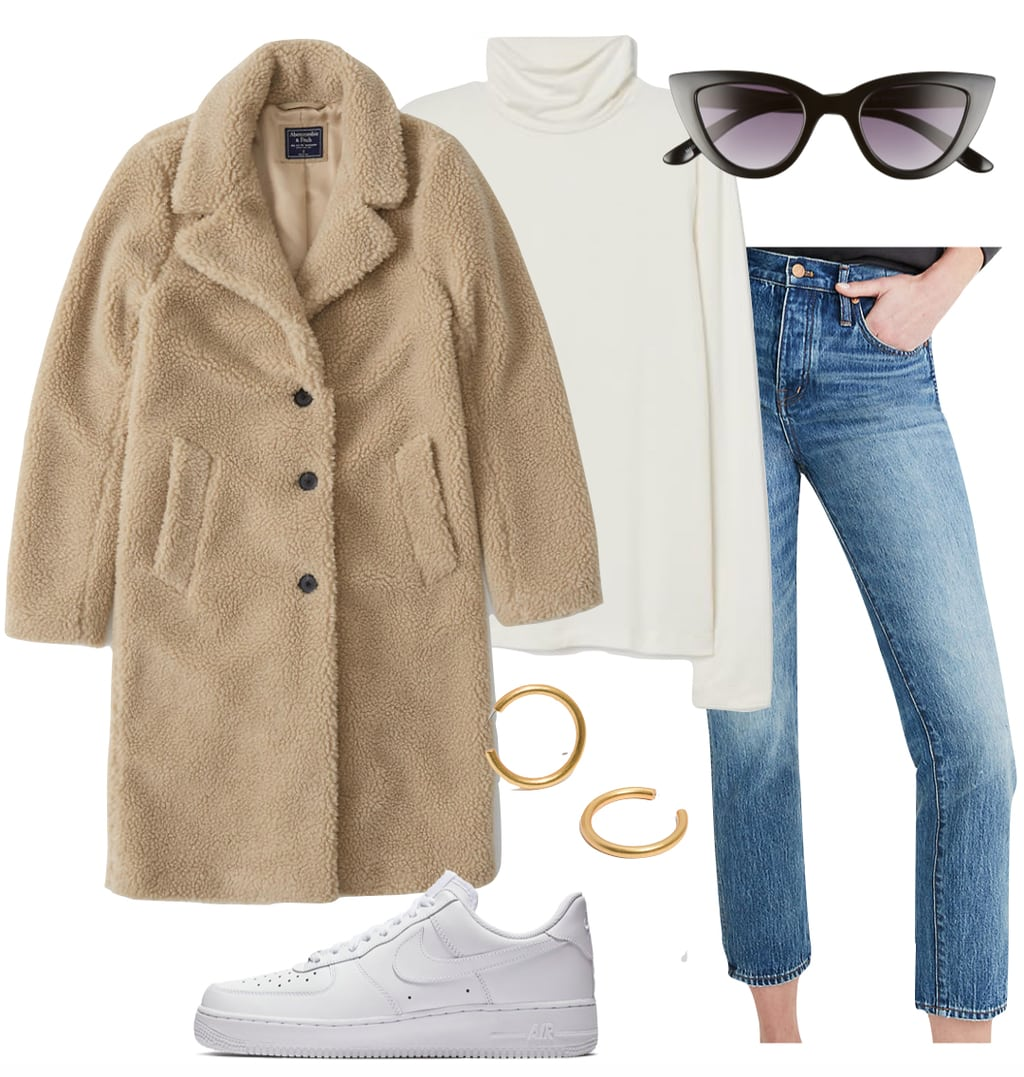 Emily Ratajkowski Outfit: beige teddy coat, white turtleneck top, straight leg jeans, white Nike Air Force 1 sneakers, and black cat-eye sunglasses