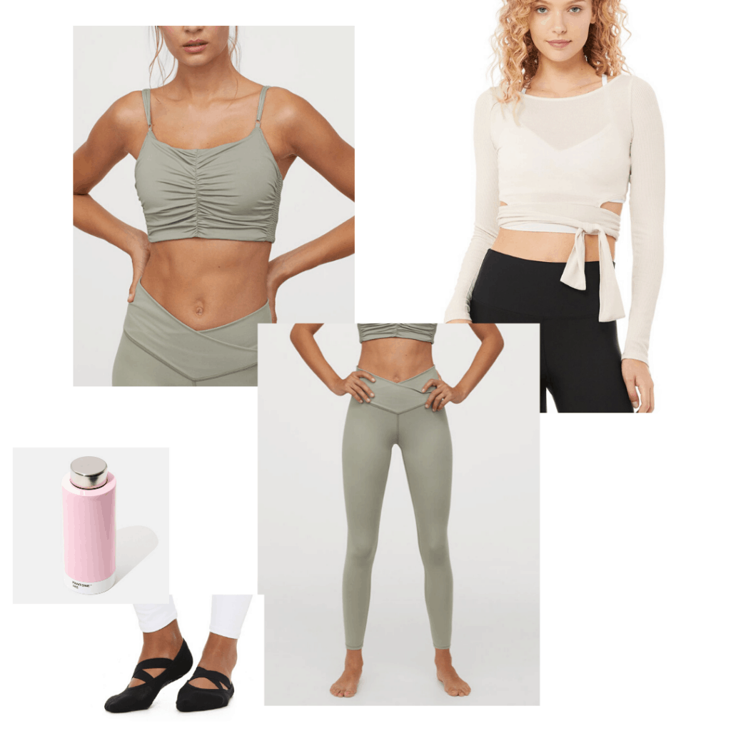 Barre workout outfit with green bra and tights, wrap top, grip socks, and pink water bottle