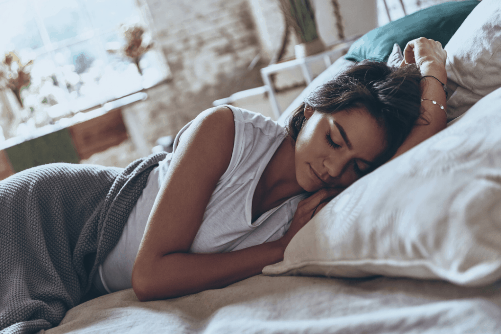Woman getting her sleep schedule on track after an all nighter