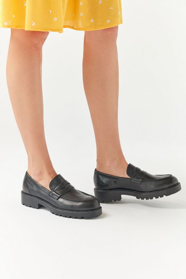 Chunky black loafers with thick soles.