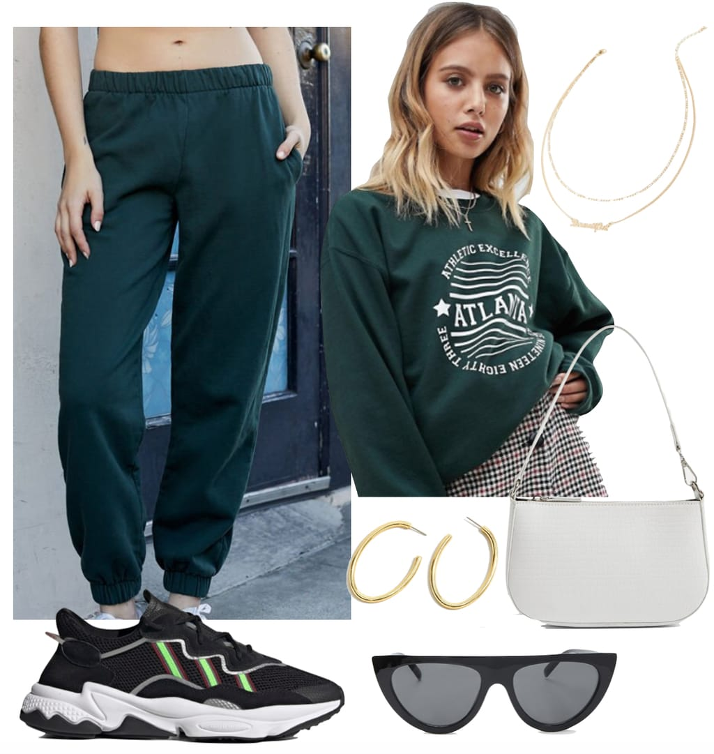 Madison Beer Outfit #1: forest green sweatpants, green crewneck sweatshirt, large gold hoop earrings, layered gold chain necklaces, white crocodile embossed shoulder bag, black angular sunglasses, and Adidas Ozweego sneakers