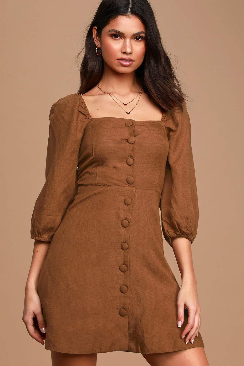 How to Wear Brown: header image of girl in brown button front dress with puff sleeves.