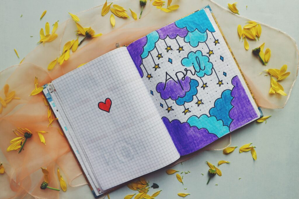 Notebook with drawing ofclouds and stars.