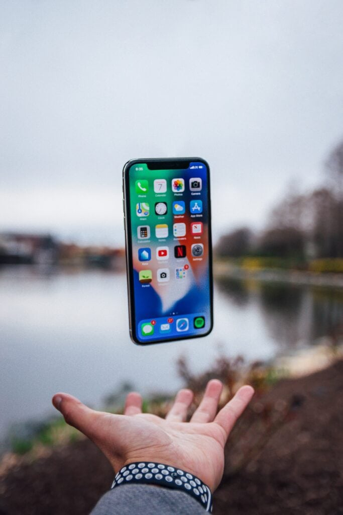 iphone floating over hand