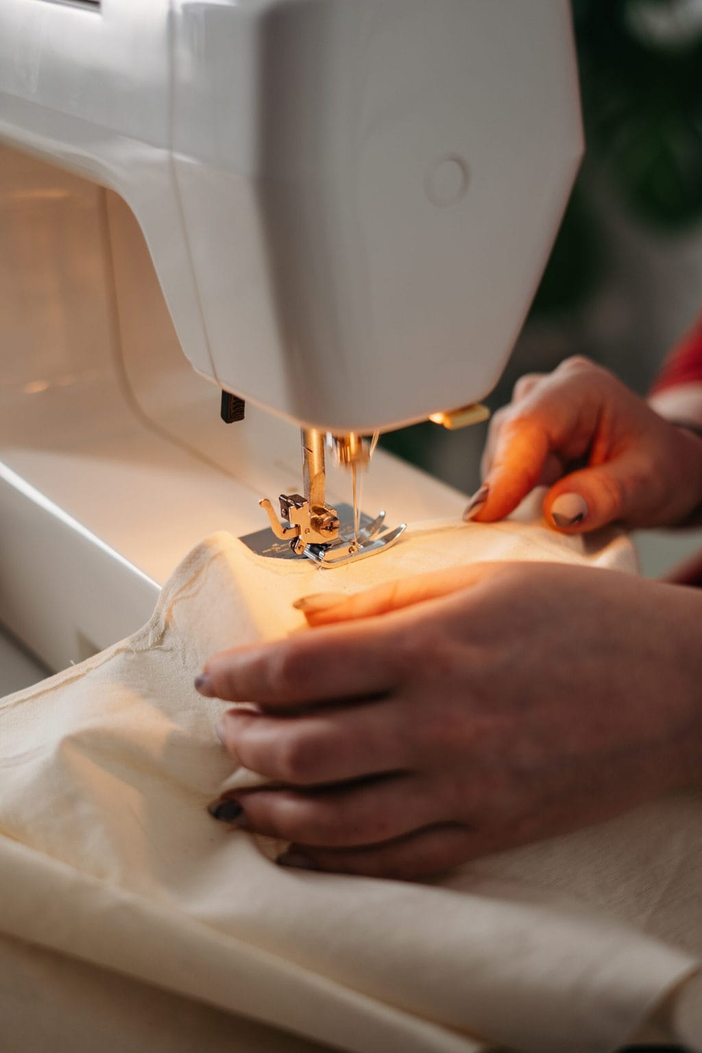 Fashion tips for big busts - get things tailored. Stock photo of sewing with a machine