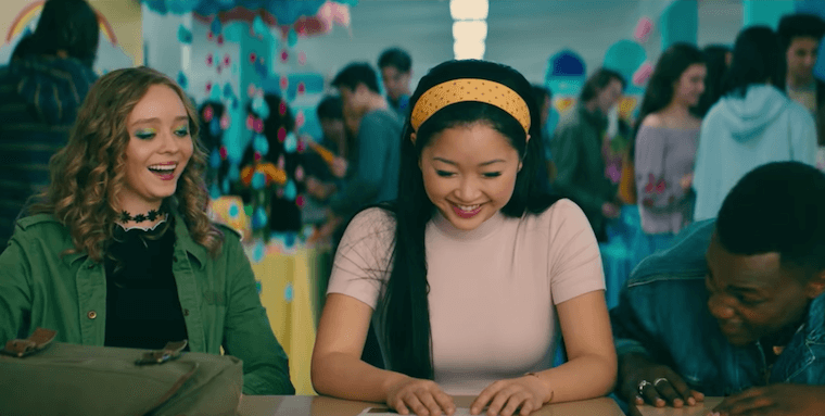 Lara Jean Covey in To All the Boys P.S. I Still Love You, wearing a pink t-shirt and yellow polka dot headband