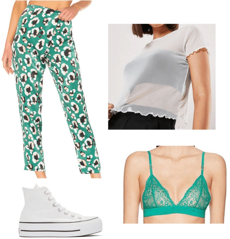 St. Patrick's Day outfit idea with green floral print pants, sheer blouse, green bralette, white sneakers