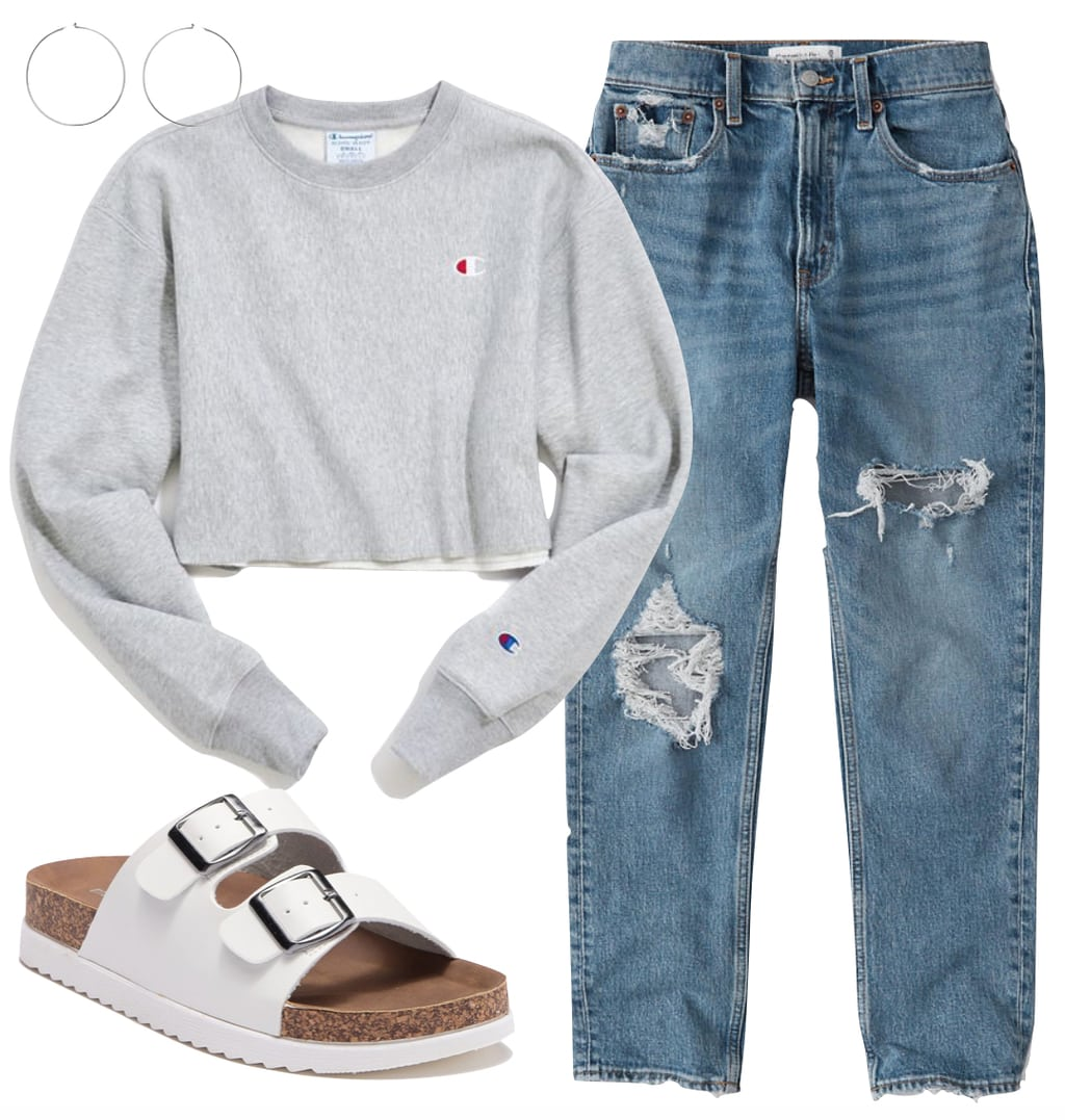 Hilary Duff Outfit 1: light gray cropped Champion crewneck sweatshirt, ripped straight leg jeans, silver hoop earrings, and white footbed sandals