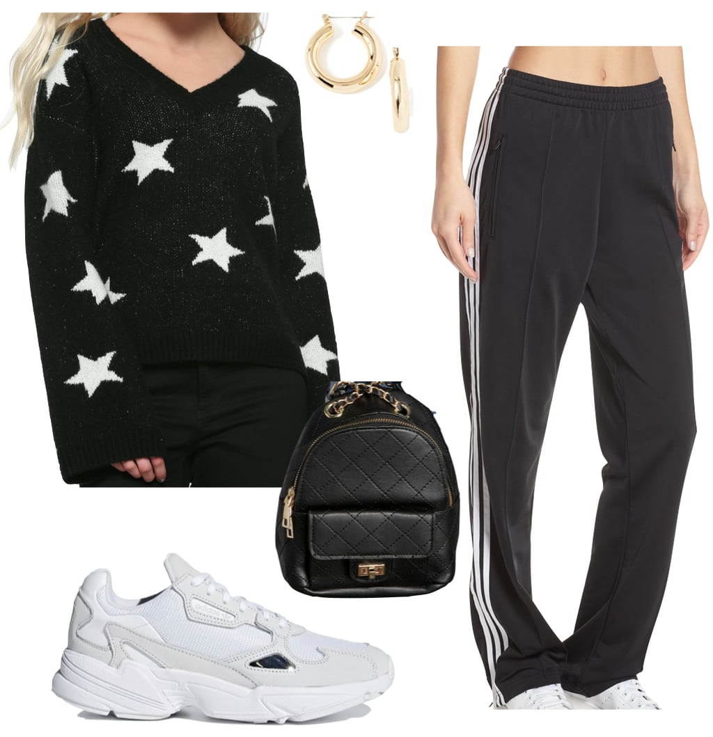 Margot Robbie Outfit: black and white star print sweater, Adidas wide leg track pants, black quilted chainlink backpack, gold hoop earrings, and chunky white sneakers