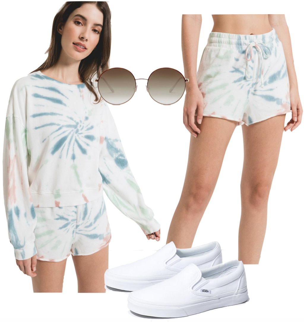 Nina Dobrev Outfit for social distancing: multicolor tie dye pullover sweatshirt and shorts, white Vans slip on sneakers, and round metal sunglasses