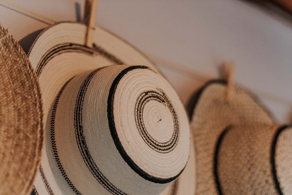 Closet organization tips - hang up your hats! Photo of hats hanging on wall.