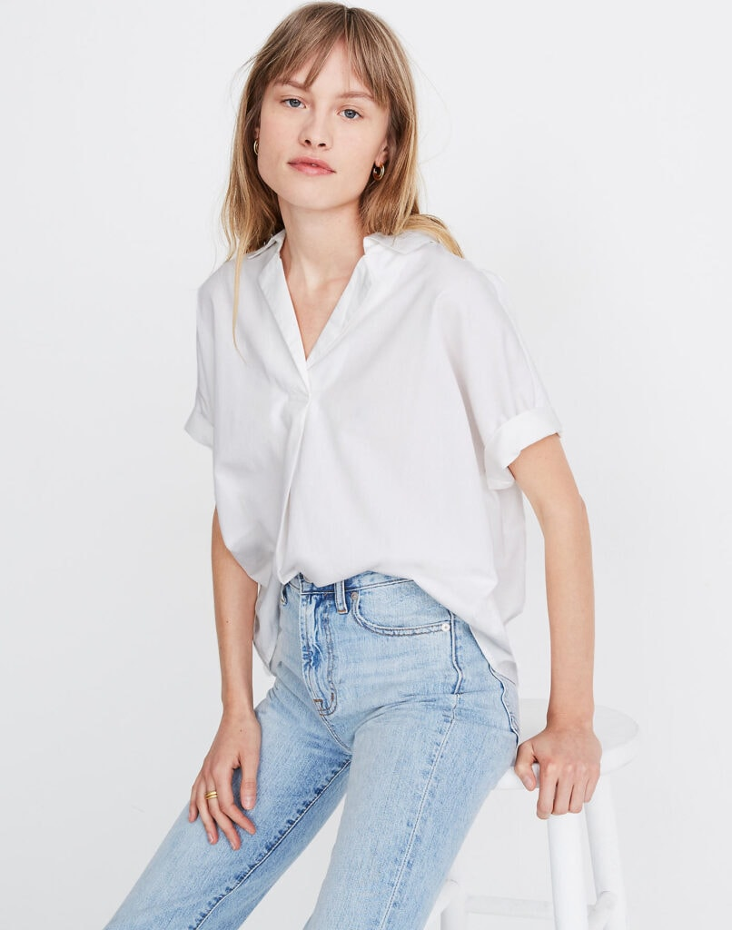 Woman with her shirt half-tucked
