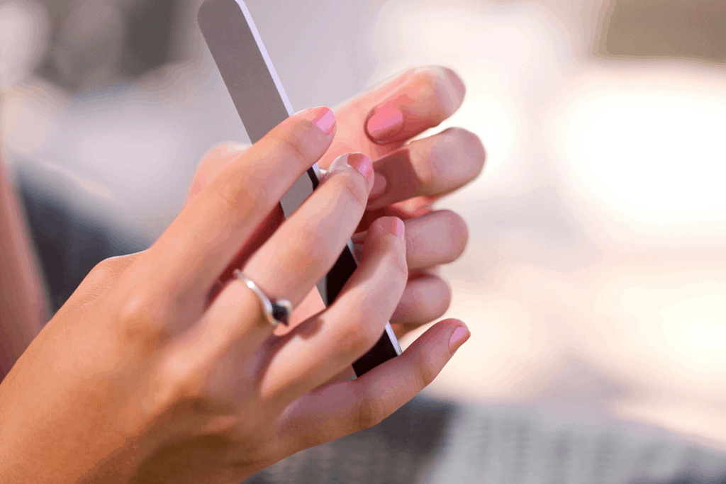 Woman filing her nails