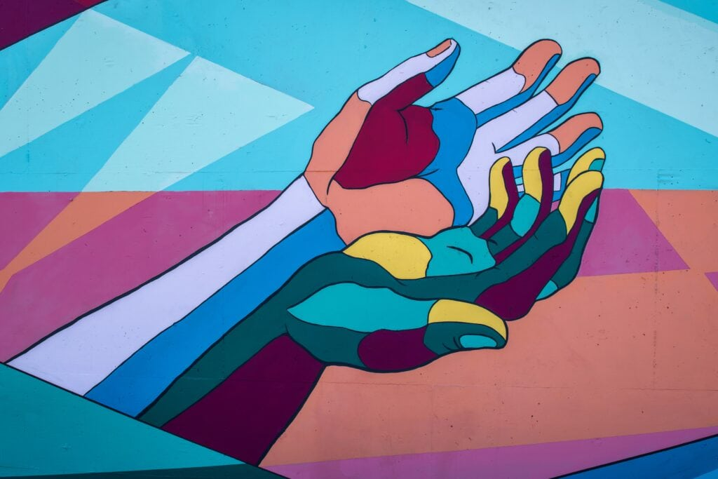 painting of colorful hands