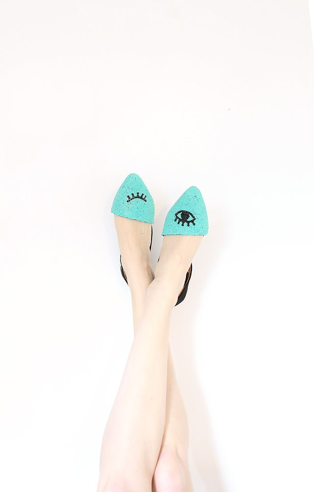 teal beaded flats with black eye detail