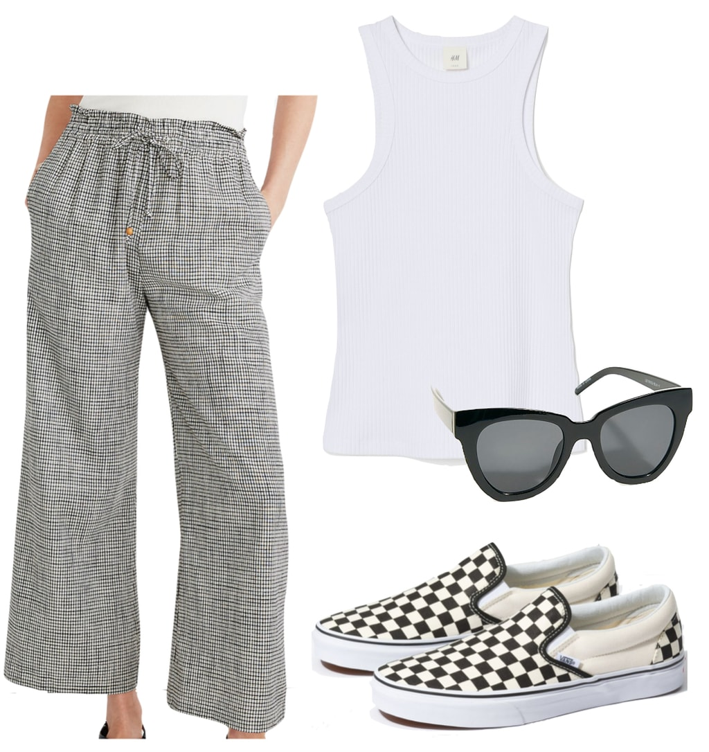 Dakota Johnson Outfit #3: white tank top, black oversized sunglasses, black and white checked pants, Vans black and white checkerboard slip on sneakers