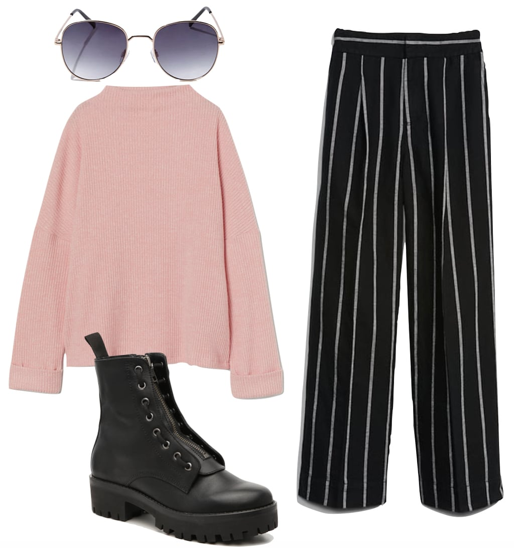 Lana Condor stripe outfit: light pink sweater, striped black wide leg pants, round metal sunglasses, and black lace-up combat boots