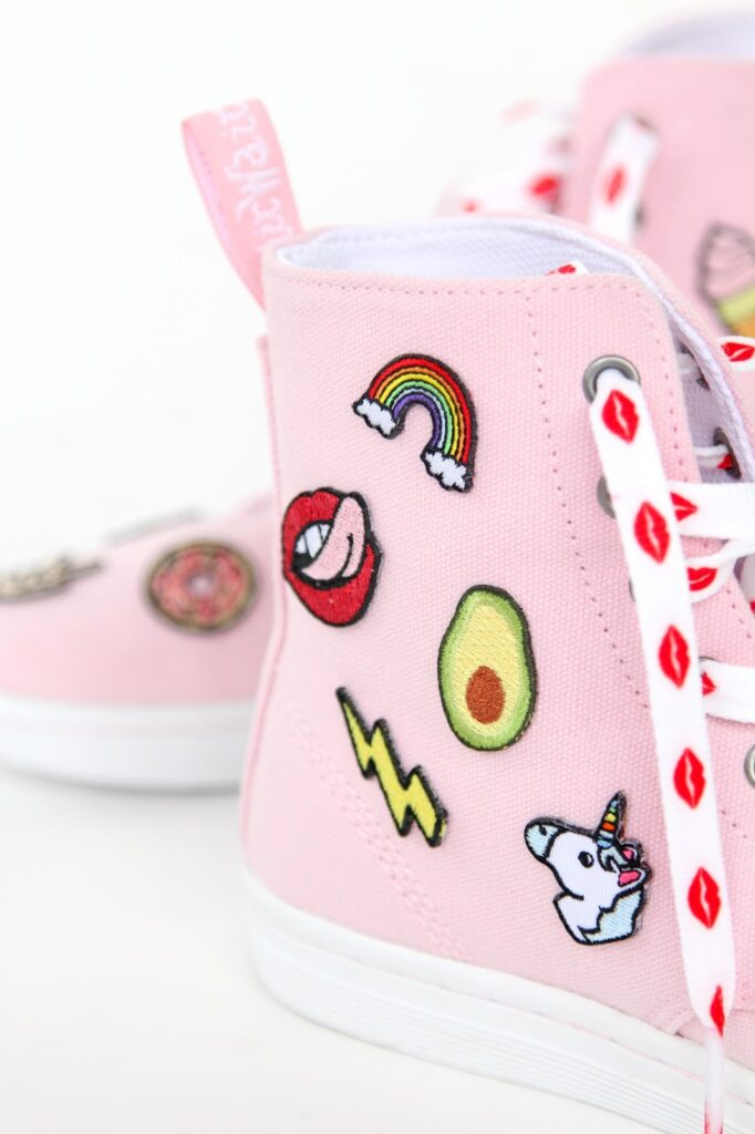 pink converse with mini patches