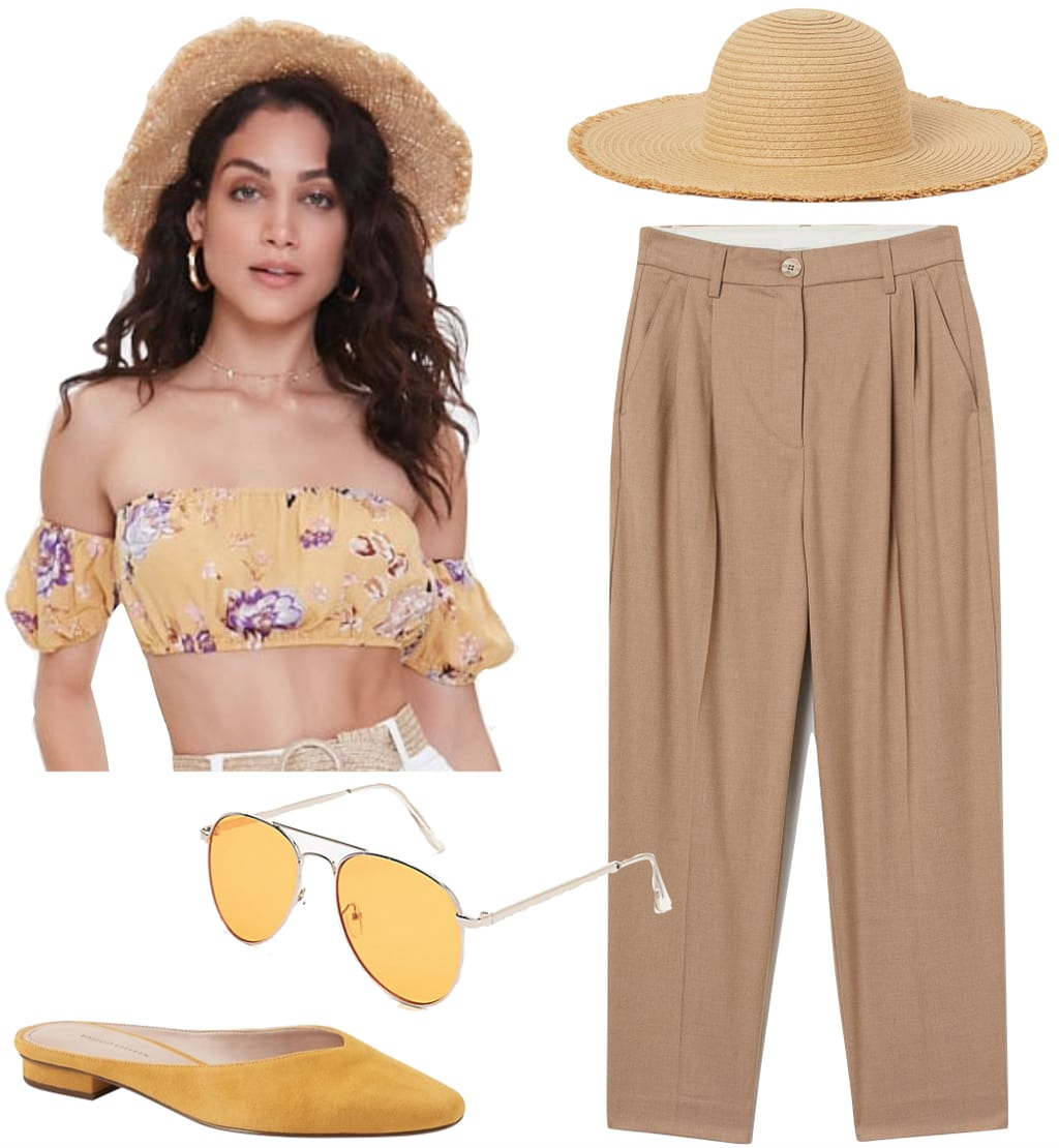 Vanessa Hudgens Outfit: beige pleated pants, yellow floral off-the-shoulder crop top, straw hat, yellow metal aviator sunglasses, and yellow mules