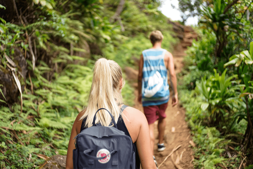 College students hiking up a mountain